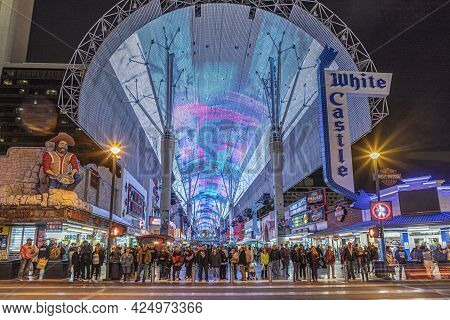 Las Vegas, Usa - March 9, 2019:  People Crossing The Road At Illuminated Casinos At Fremont Street I