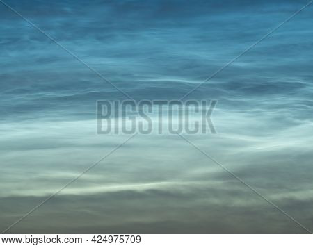Starry Sky With Noctilucent Clouds At Summer Solstice Night. Fantastic Cloudscape. Natural Pattern,