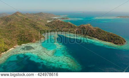 Aerial View Tropical Island Bulalacao With Blue Lagoon, Coral Reef And Sandy Beach. Palawan, Philipp