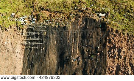 Workers Strengthen The Slope Of The Mountain With Metal Mesh Preventing Rockfall And Landslide On Th