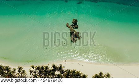 White Beach Of Boracay And People Swim At Turquoise Azure Sea Near Grotto Willys Rock Upon Which Sta