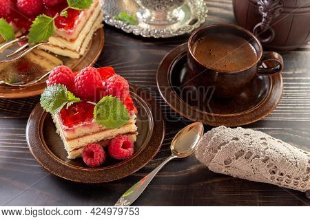 Cake. A Piece Of Beautiful Raspberry Cake On A Plate. A Cup Of Coffee. Festive Food. Bouquet Of Red