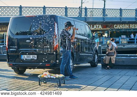 Turkish Street Vendor Take Attention To His Stuff Use Soap Bubbles. Turkey , Istanbul - 21.07.2020