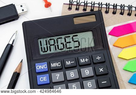 Calculator With The Word Wage On The Display