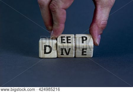 Deep Dive Symbol. Businessman Turns Wooden Cubes With Words 'deep Dive'. Beautiful Grey Background.