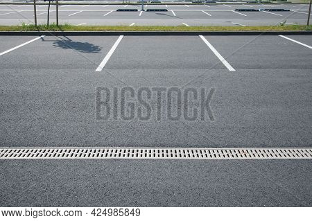 Large Parking Lot With White Asphalt Parking Lines.