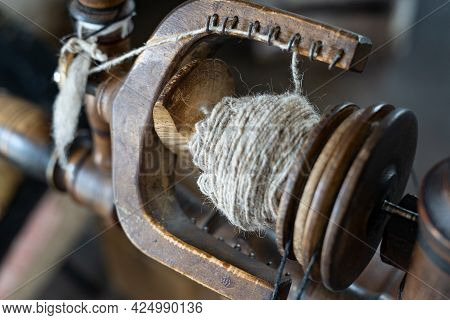 Thread In The Old Spinning Wheel Wool