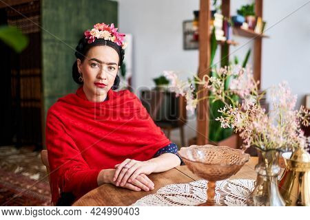 Beautiful Young Woman In The Image Of The Famous Artist Frida Kahlo Posing For The Camera