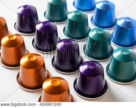 Many Aluminum Coffee Capsules Are Displayed In A Row On A White Background. Food Pattern. Capsules F