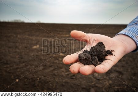 Closeup Wideangle View At Soil Being Held In Farmer's Hand