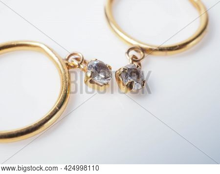 Close Up Shoot Of A Pair Of Golden Earrings With Diamonds