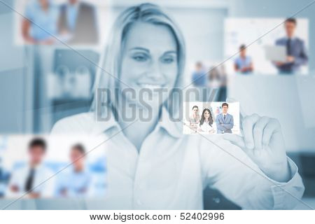 Delighted attractive blonde woman catching a picture on digital screen