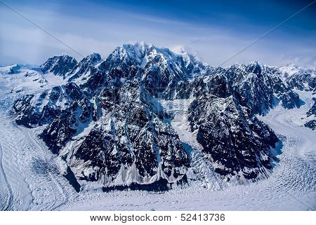 Aerial View of Ice Sculpted Mountain Tops in the Great Alaskan Wilderness, Denali National Park.