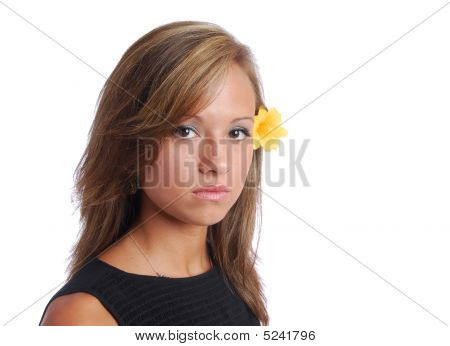 Dark Haired Girl With Yellow Flower