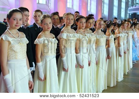 MOSCOW - FEB 22: The girls dressed in white dresses on the Kremlin Cadet Ball in Manege, on February 22, 2013 in Moscow, Russia. In 2013, Ball is timed to the 400th anniversary of the Romanov dynasty.