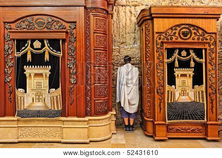 JERUSALEM - AUGUST 21: Two wooden cabinets with Torah scrolls and prayer in Cave Synagogue which is a part of Western Wall - Judaism's holy place in Jerusalem, Israel on August 21, 2013.