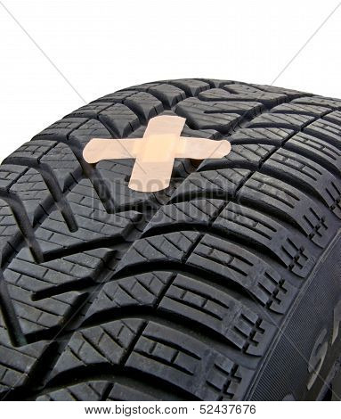 Car Tyre with Plaster