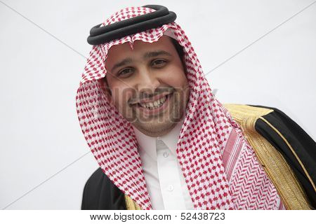 Portrait of smiling young man in traditional Arab clothing