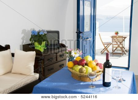 romantic interior of traditional cave house villa built into caldera cliff overlooking mediterranean sea in oia ia santorini greek islands greece poster