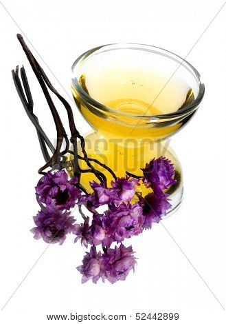 aromatic oil with purple flowers
