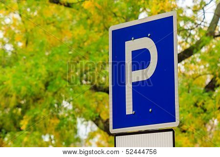 Road Sign Parking On A Yellow Foliage Background In The Park