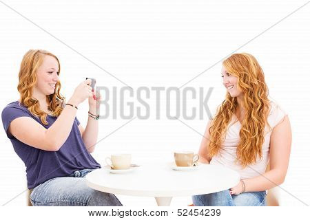 Redhead Woman Making Photos Of Her Friend