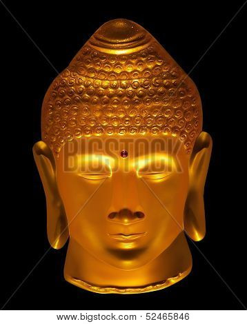Close up face of Golden Buddha isolated black