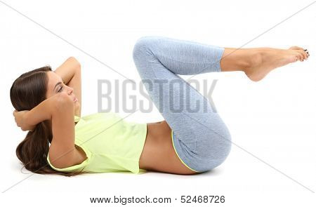 Young beautiful fitness girl doing yoga exercise isolated on white