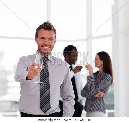 Happy Businessman Celebrating A Success With Champgane