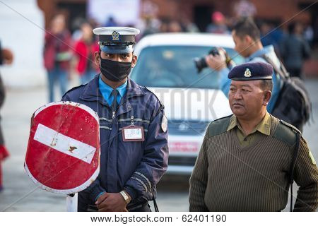 KATHMANDU, NEPAL - NOV 29, 2013: Soldiers during protest within a campaign to end violence against women (VAW) Held annually since 1991, 16 days from Nov 25 to Dec 10.