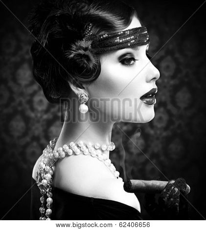 Retro Woman Portrait. Vintage Styled Girl With Cigar. Smoking Lady. Vintage Styled Black and White Photo. Old Fashioned Makeup and Finger Wave Hairstyle. 20's or 30's style.