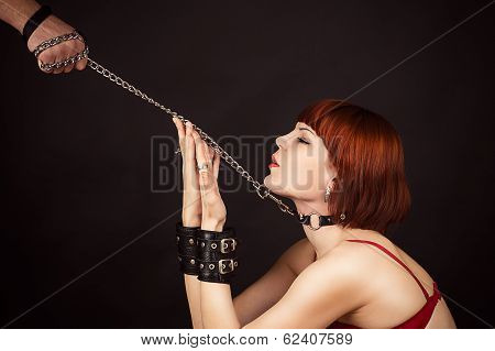 woman in the role of a slave on a leash