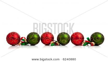 Red And Green Christmas Ornaments With Ribbon On White