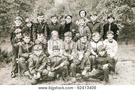 POLAND, CIRCA 1980's: Vintage photo of group of  boys posing together  during a summer camp