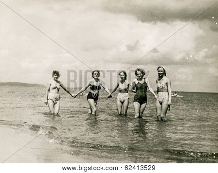 POLAND, CIRCA 1940's: Vintage portrait of four women bathing in sea