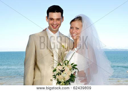 Happe wedding couple are smiling and looking
