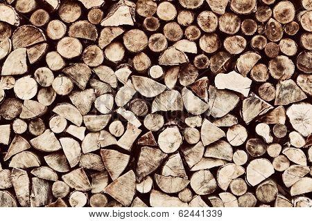 Pile of brown wood logs background, pattern. Vintage tone