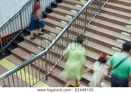 people walking on the stair in subway station poster
