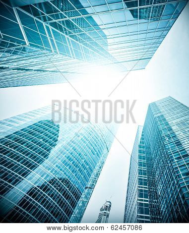 Panoramic and prospective wide angle view to steel light blue background of glass highrise building skyscraper, commercial modern city of future. Business concept of successful industrial architecture