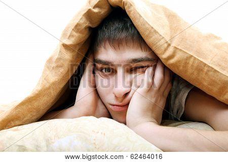 Bored Teenager Under Blanket