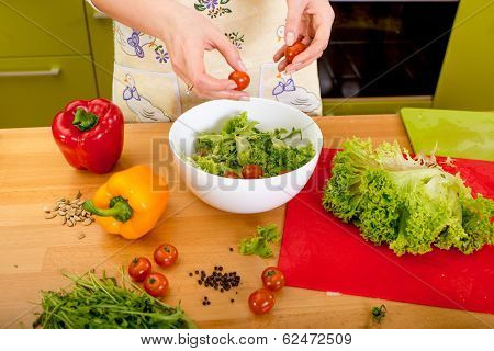 Woman Preparing Salad With Tomatoes, Pepper And Avocado On The Red Board In The Kithen, Close-up Pla