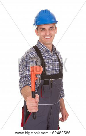 Portrait Of A Male Worker Holding Worktool