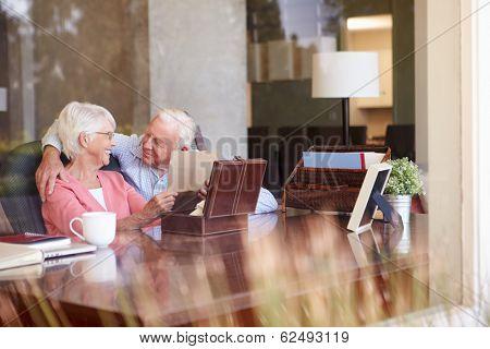 Senior Couple Putting Letter Into Keepsake Box
