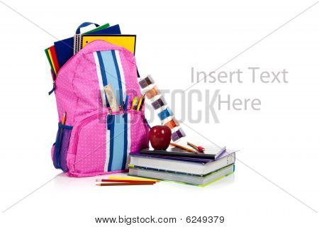 Pink Backpack With School Supplies With Copy Space