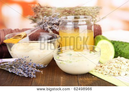 Homemade facial masks with natural ingredients, on color wooden table, on bright background