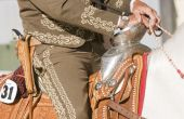 Close up of the silver boss on an ornate hispanic saddle. poster