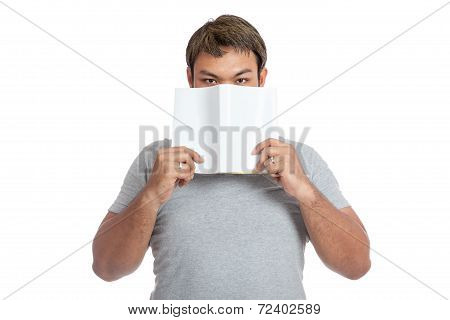 Asian Man Close His Mouth With A Book Look At Camera