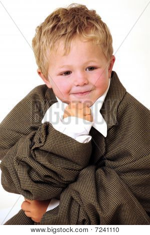 Boy in oversized business clothes in thinking position