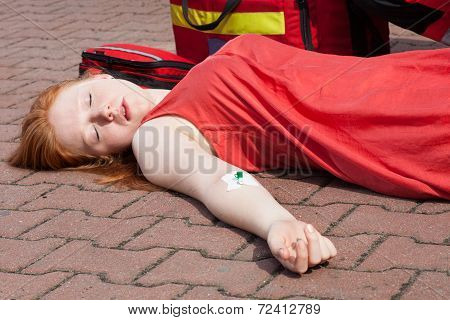 Unconscious Girl With Intravenous Cannula