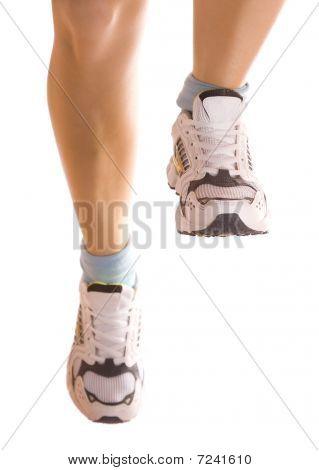 Running Girl`s Legs Isolated On White.